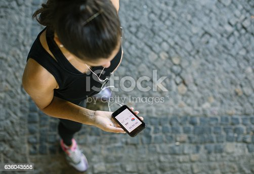 istock Woman monitoring her workout progress on fitness app 636043558