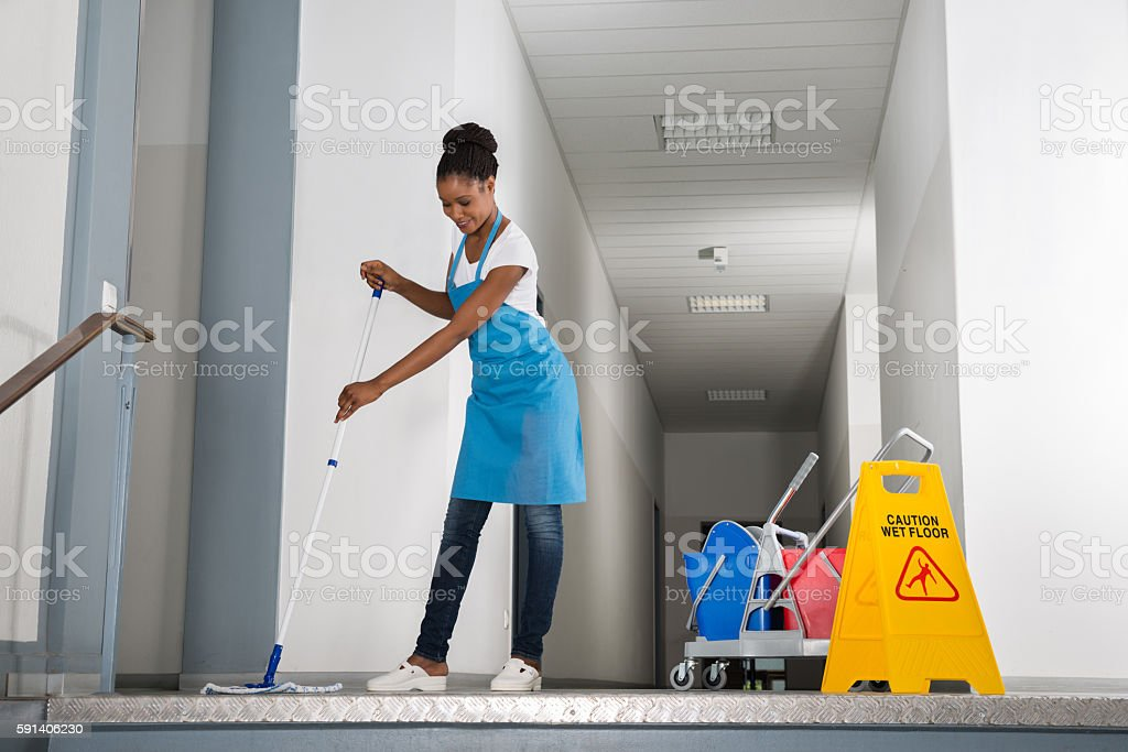 Woman Mopping Corridor stock photo