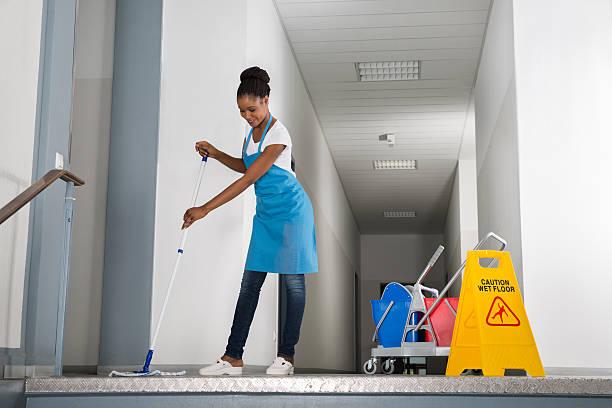 Woman Mopping Corridor stock photo