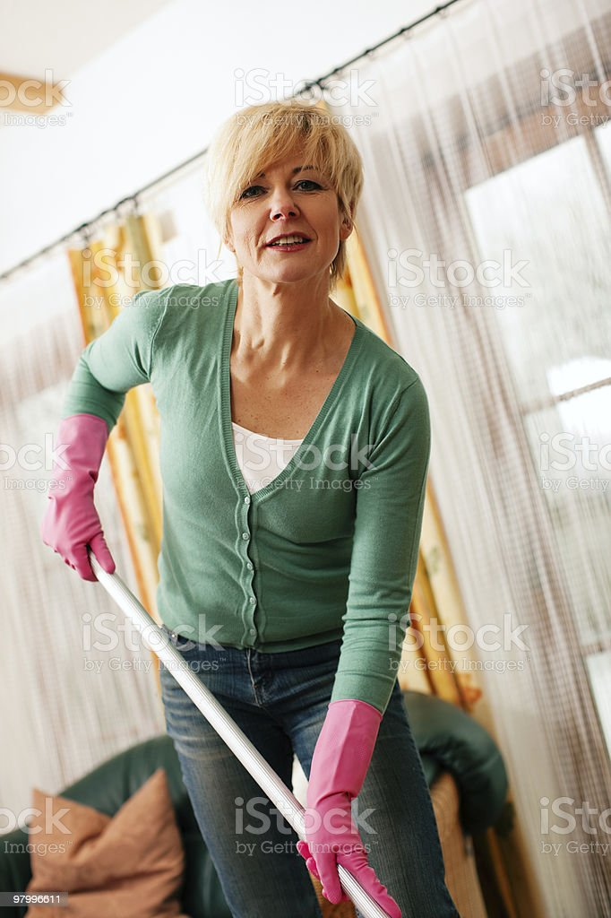 Woman mopping the floor in her home royalty-free stock photo
