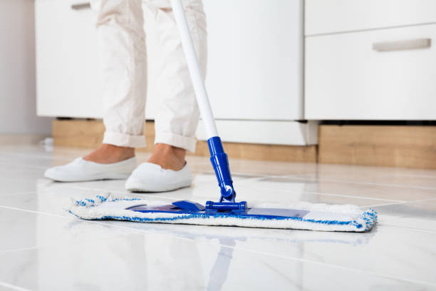 Woman Mopping The Floor In Kitchen Cleaning Service Woman Mopping The Floor In Kitchen At Home mop stock pictures, royalty-free photos & images