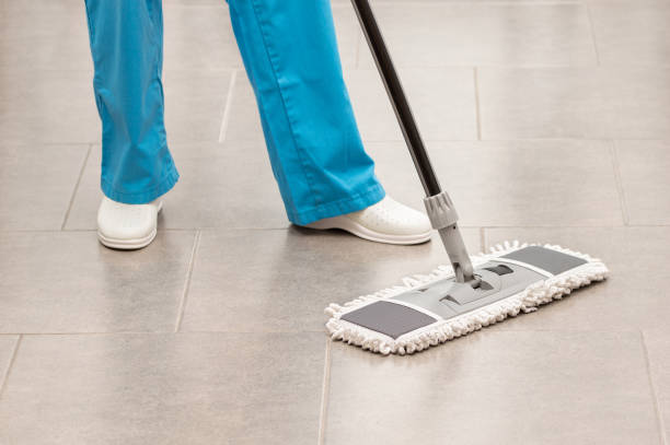 woman mopping the office floor stock photo