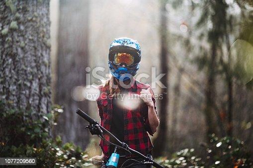 istock Woman Mountain Biking On Forest Trails 1077209560