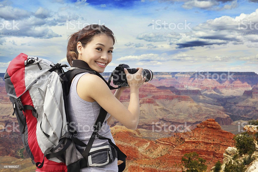 woman mountain hiker taking pictures stock photo