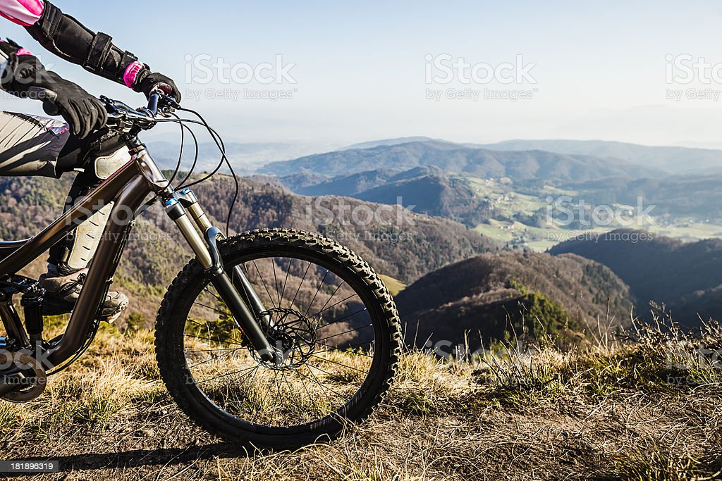 Woman mountainbiker on top royalty-free stock photo