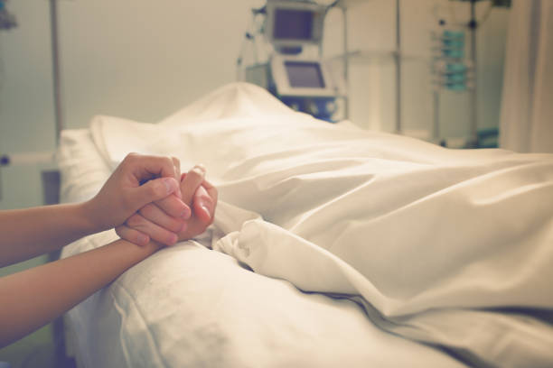 woman mourns her husband, who died in a hospital - death stock pictures, royalty-free photos & images