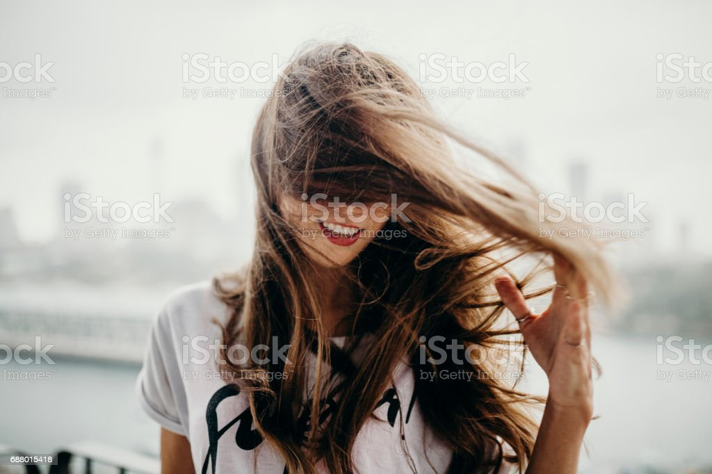 Woman moving and touching her haire. stock photo