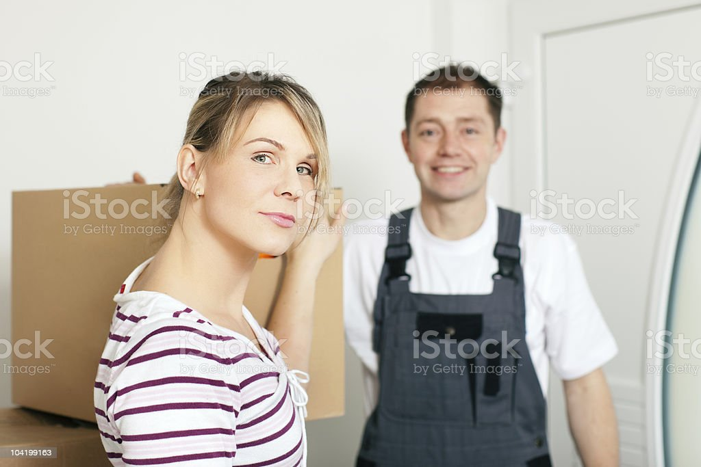 Woman moving in her new house royalty-free stock photo