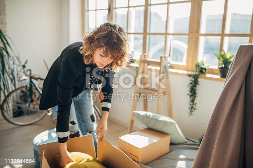 Young woman moving in into new apartment