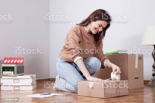 Woman moving into new home with boxes picture id1185964294?b=1&k=6&m=1185964294&s=612x612&h=ap9esfcnjoyrhi gvebn02cfxtl80z5kwloohogzjni=