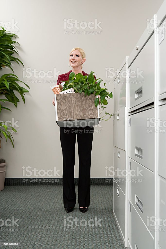 Woman moving office stock photo