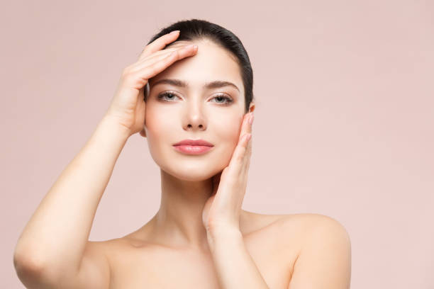 Woman Natural Beauty Makeup Portrait, Fashion Model Touching Face by Hands, Skin Care and Treatment stock photo