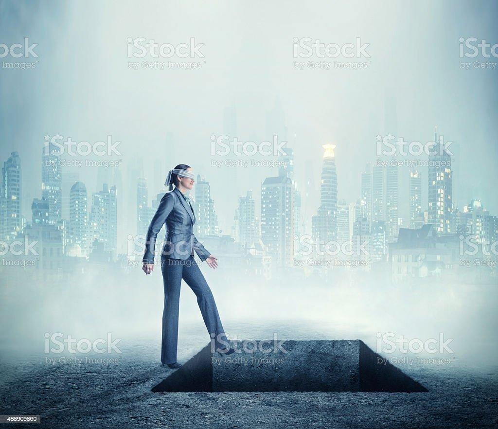 Woman near a deep pit stock photo