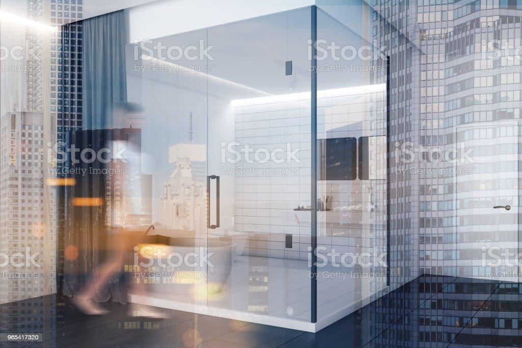 Woman near a luxury hotel shower stall zbiór zdjęć royalty-free