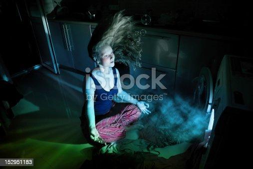 487597124 istock photo Woman near by washing machine underwater 152951183