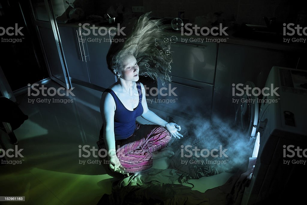 Woman near by washing machine underwater stock photo