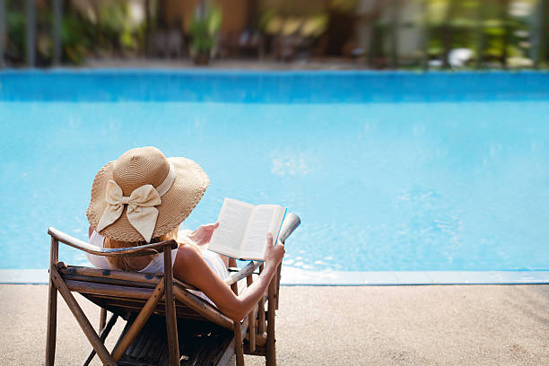 woman near luxury swimming pool stock photo