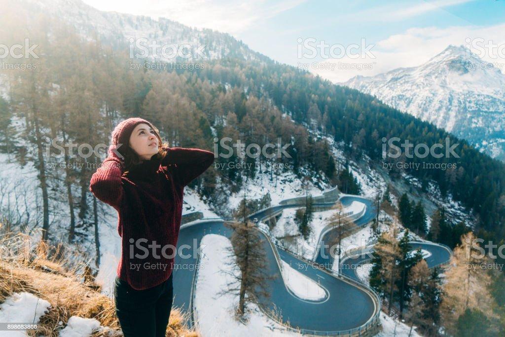 Woman near Maloja pass in Switzerland stock photo