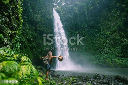 Woman near Nung Nung waterfal on Bali, Indonesia