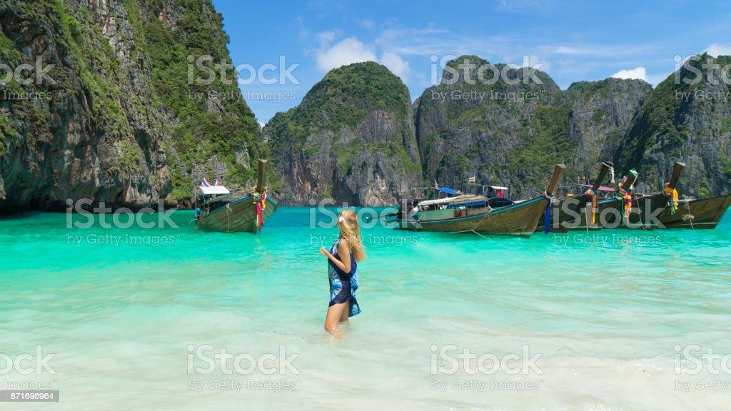 woman near Thai Taxi Boats stock photo
