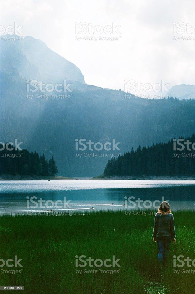 Woman near the Black lake stock photo