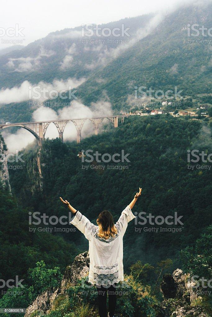 Woman near the bridge on Tara river stock photo