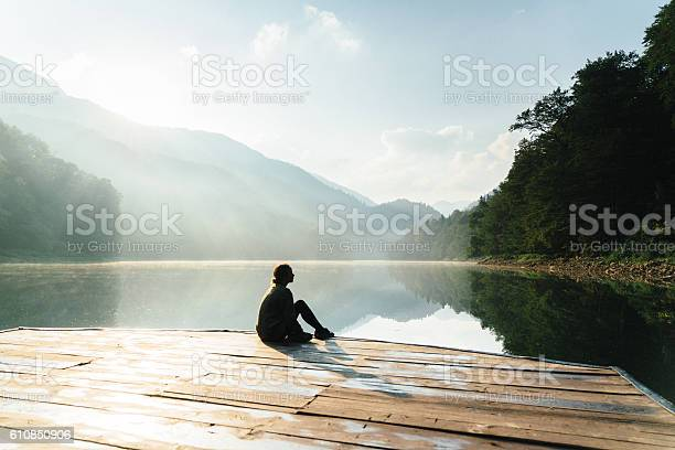 Photo of Woman near the lake in mountains