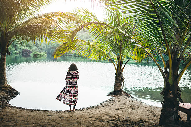 Woman near the lake Woman standing near the lake in jungles  goa stock pictures, royalty-free photos & images