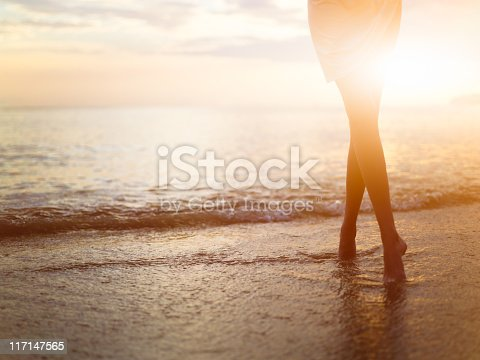 istock Woman near the ocean. Sunset time. 117147565