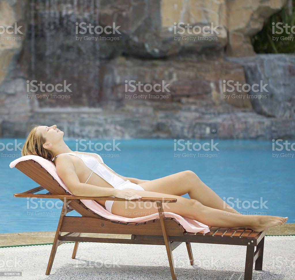 Woman near the swimming pool royalty-free stock photo
