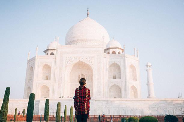 Woman near the Taj Mahal Woman looking at Taj Mahal  agra stock pictures, royalty-free photos & images