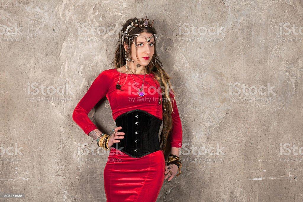 Woman near the wall stock photo