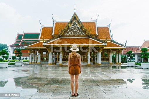 Young Caucasian woman walking  near the Wat Ratchanatdaram in Bangkok