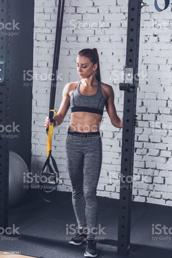 woman near trx gym equipment royalty-free stock photo