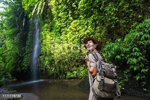 Woman near waterfal on Bali, IndonesiaÂ