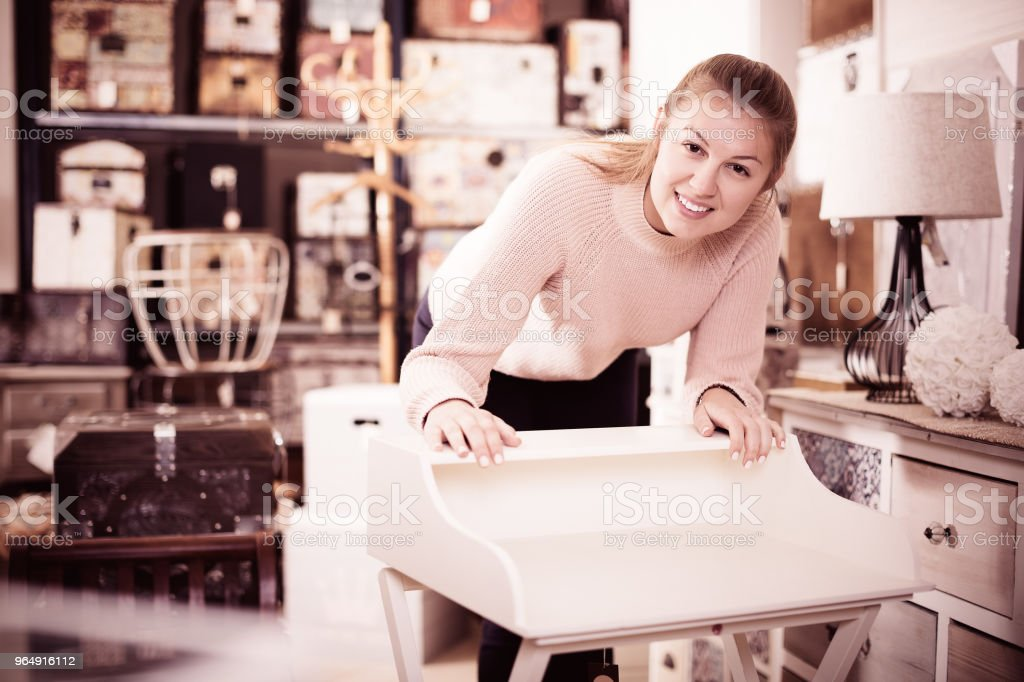 Woman near wooden table with drawers royalty-free stock photo