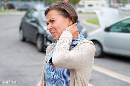 istock Woman neck hurt after car crash on the street 856951646
