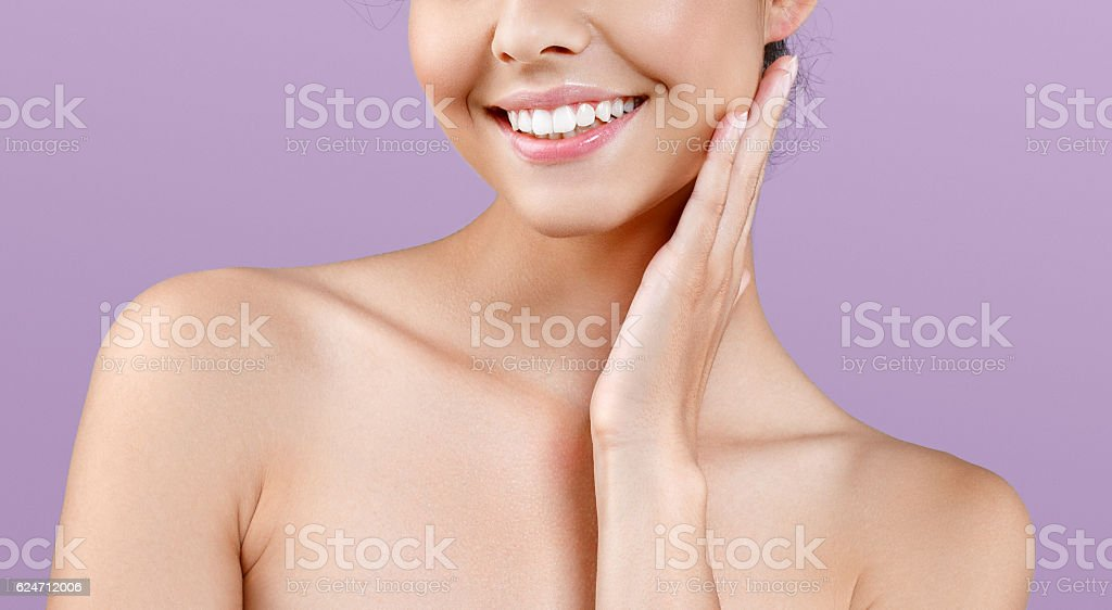 Woman neck shoulder lips nose portrait. Pink background. stock photo