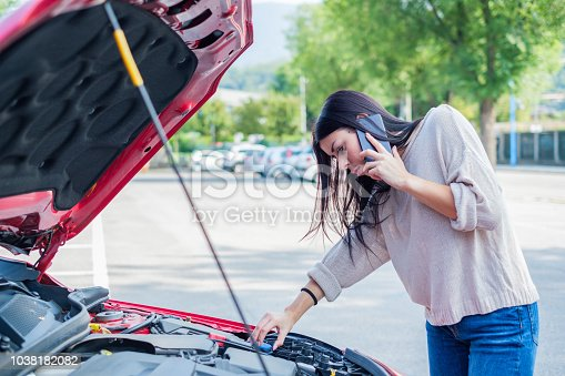 860373412 istock photo Woman need help after vehicle and engine breakdown 1038182082