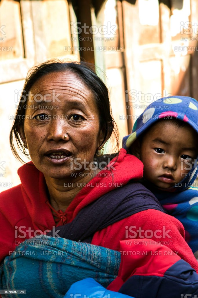 Woman Nepal and her kid stock photo