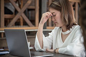 istock Woman nervous frightened to lost job infected corona covid-19 virus infectious.Working woman migraine headache sick from stress exhausted office syndrome  Economic crisis world epidemic infection 1250904600