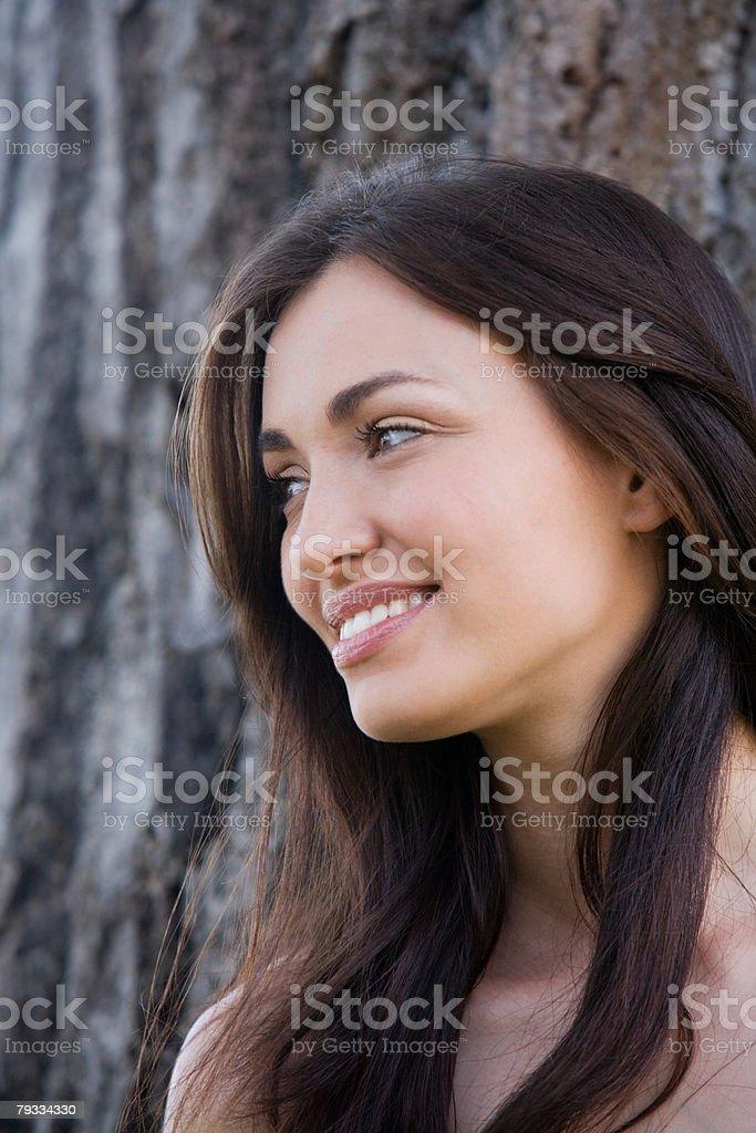 Woman next to a tree royalty-free stock photo