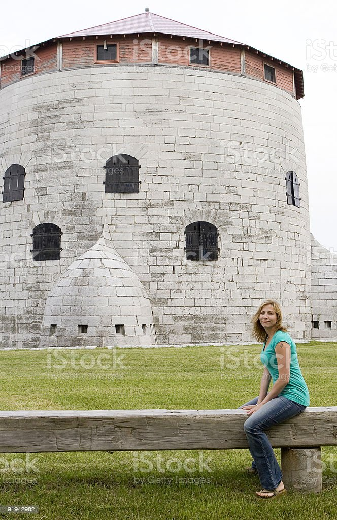 Woman next to tower stock photo