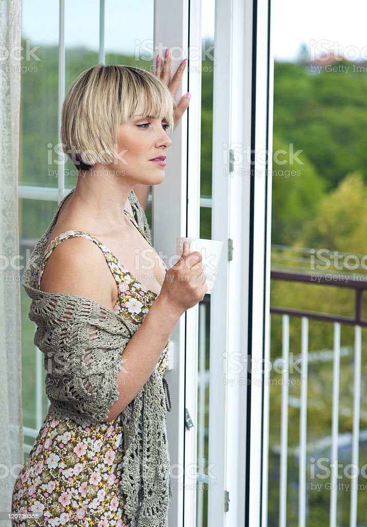 woman next to window in the morning royalty-free stock photo