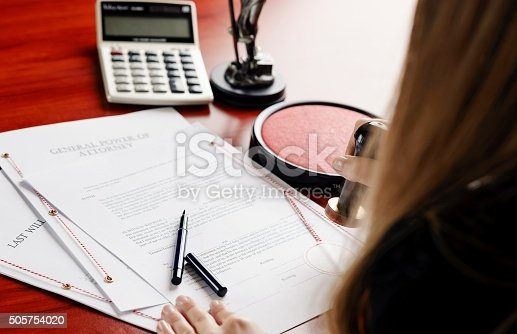 854317150istockphoto Woman notary public notarize document 505754020
