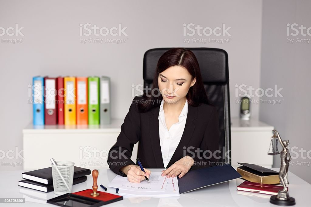 Woman notary public notarizes the power of attorney stock photo