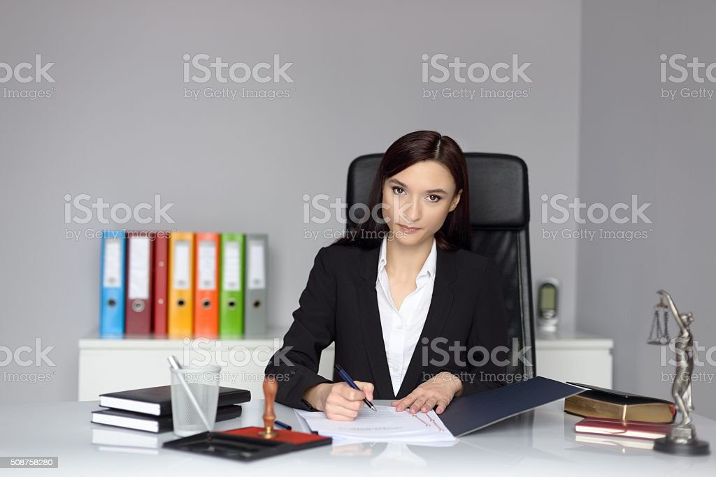 Woman notary public signing the power of attorney stock photo