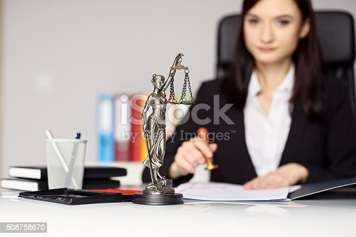 854317150istockphoto Woman notary public  stamping the document. 508758670