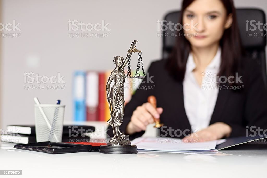 Woman notary public  stamping the document. stock photo