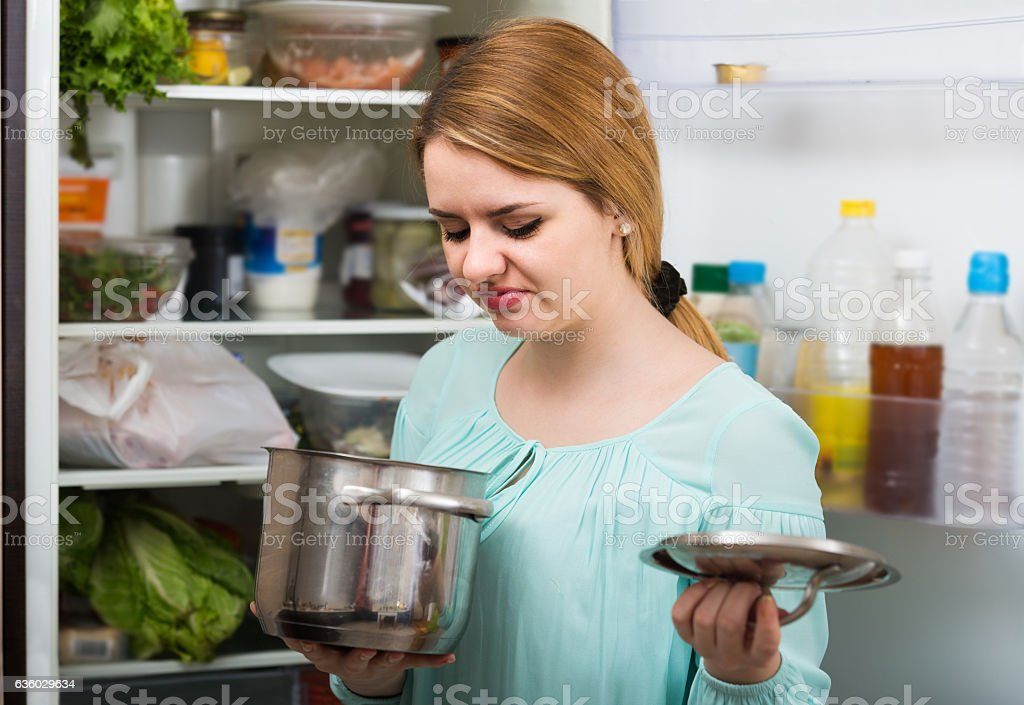 woman noticed foul smell of food from casserole stock photo